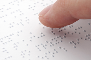 braille finger reading braille text