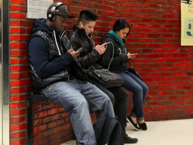 people playing on iPhones
