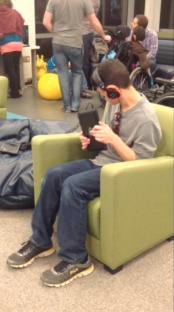 Teen playing blindfold racer
