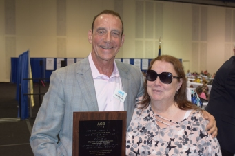 Marty and Kim Charlson with the ACB award